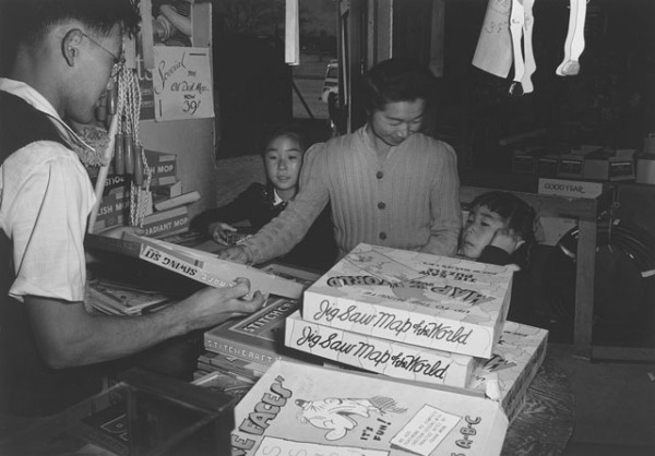 "Copyright Ansel Adams: ""Mrs. Yaeko Nakamura and family buying toys with Fred Moriguchi."""